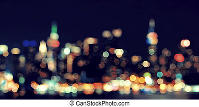 Midtown Manhattan skyline bokeh at dusk panorama over Hudson...