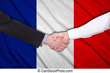 France flag - handshake on a France flag background