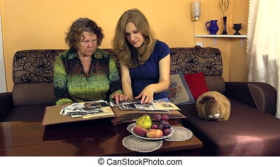 woman watch photo room - happy grandmother watch black and...