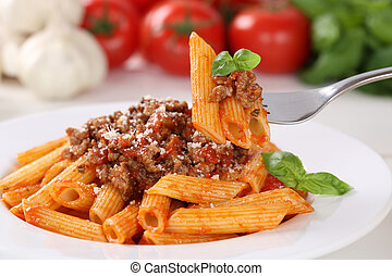 Eating pasta Bolognese or Bolognaise sauce noodles meal on a...