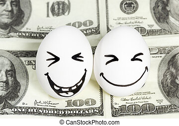 Eggs with faces on money - Two eggs with painted faces...