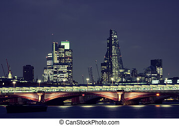 London over river - Blackfriars Bridge and London skyline at...