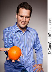 Diet and healthy nutrition. Man recommending orange - Diet...