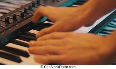 Playing piano - A person who plays the piano beautifully
