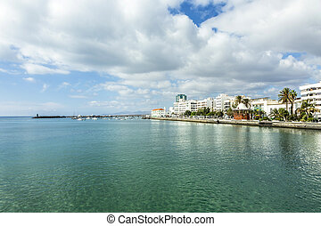 seaside view to promenade of Arrecife with boats - seaside...