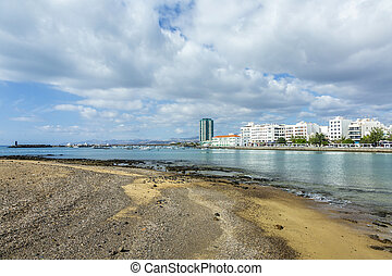 seaside view to promenade of Arrecife, Lanzarote with boats