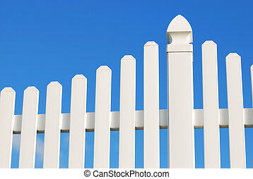 white fence over the blue sky background