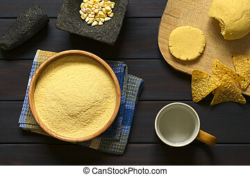 Cornmeal - Overhead shot of cornmeal in wooden bowl with...