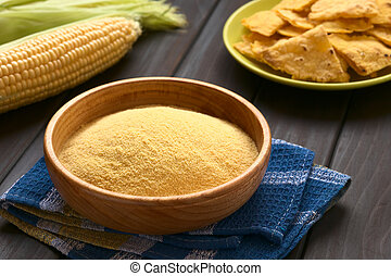Cornmeal - Wooden bowl of cornmeal with homemade tortilla...