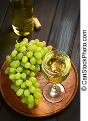 Glass of White Wine and Grapes