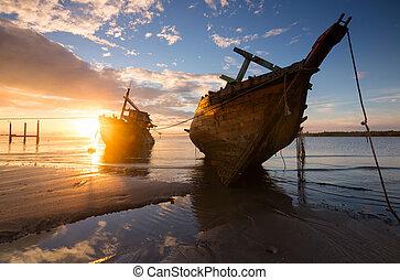 Wrecked ship at sunrise in Kuala Penyu, Sabah, Borneo,...