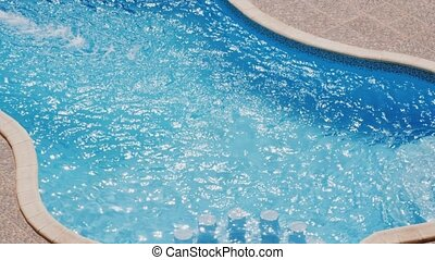 Water surface on swimming pool in sunny day
