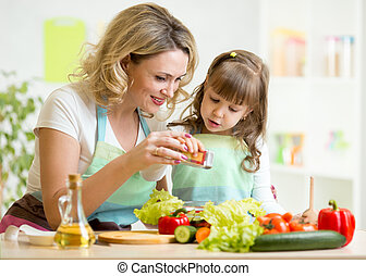 mother with kid make salad - mother with kid make vegetable...