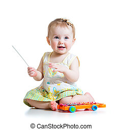 smiling child playing with musical toy - smiling child boy...