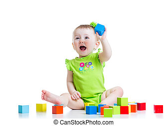 happy child girl playing toys isolated