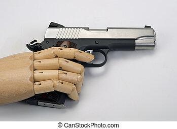 45  caliber handgun. - 45 Caliber handgun with wooden arm.