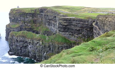 Cliffs of Moher and Atlantic Ocean. Most famous landmark in...