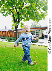 child fashion concept with beautiful little child outdoor in nature