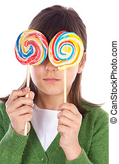 Girl eating two lollipops - Adorable girl eating two...
