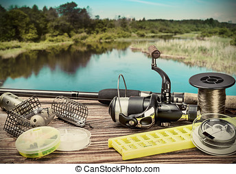 fishing tackle on a pontoon on the background of the lake in...