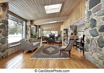 Western style family room with wood and stone