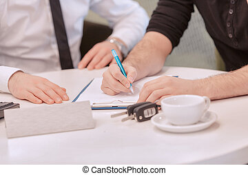 Close up of a male customer signing the contract - Sign up...