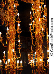 old mirror with golden lamps