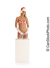 Young sexy Santa gets out of the box isolated on white