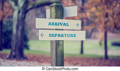 Rural signboard with two signs saying - Arrival - Departure...
