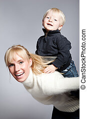 Happy caucasian mother and son - A portrait of a happy...