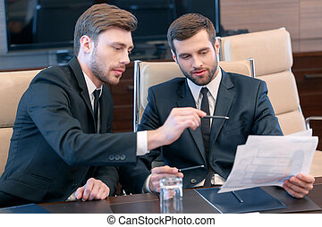 Businessmen at work - Smart solutions for business. Two...