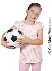 girl holding a soccer ball