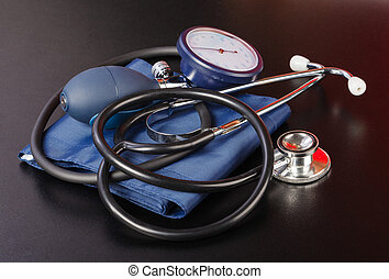 Blood pressure measuring device on isolated black background