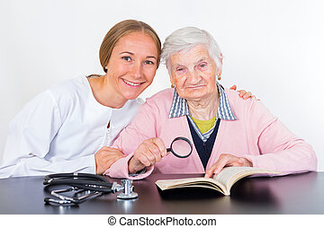 Elderly woman and young doctor - Photo of elderly women with...