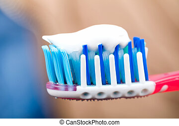 Toothbrushing - Close up photo of toothbrush with toothpaste
