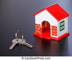 Miniature house and keys - Photo of a miniature house and...