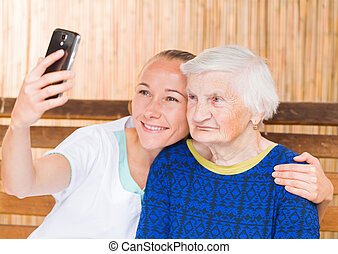 Elderly woman with caregiver - Elderly woman with her...