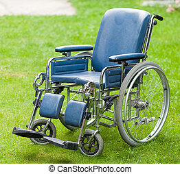 Wheelchair - Photo of a wheelchair on green grass