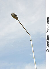 street lights against blue sky