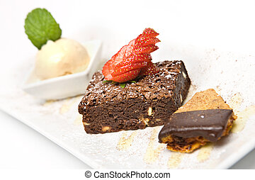 Chocolate Brownie - Classic Chocolate brownie served with...