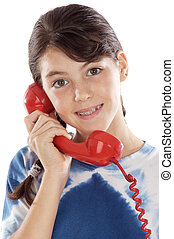 Girl on the phone - Young girl speaking on the telephone a...