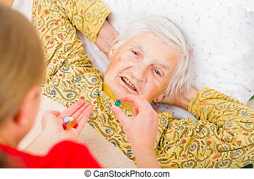 Elderly home care - Photo of elderly woman taking the...