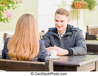 Young couple dating on the terrace of the restaurant