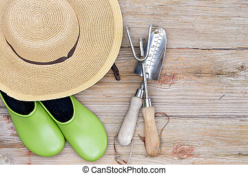 Hat, Gardening Shoes and Tools on Wood Background - Overhead...