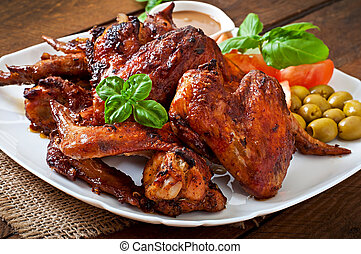 chicken wings - Plate of chicken wings on wooden background