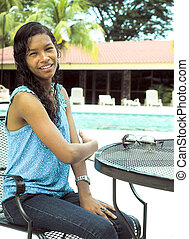 pretty Creole native Nicaraguan woman by pool hotel Managua...