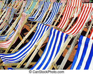Deckchairs - Empty deckchairs blue and red candy striped...