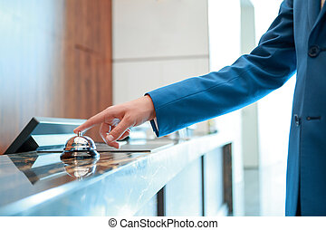 Hotel service bell at reception - Service, please. Closeup...