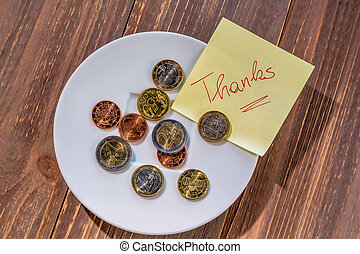 plate with coins - a plate of coins for tips or fee for...