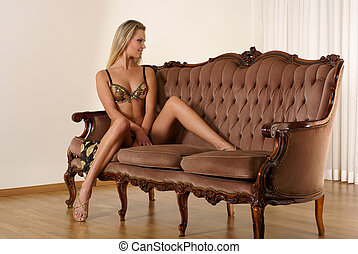Sexy lady on a sofa